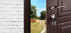 Entrance door half opened to the nature background - stock photo