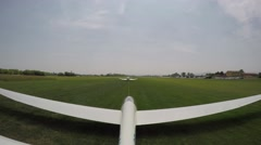 Glider (sailplane) take off from a small grass airfield. 4K UltraHD - stock footage