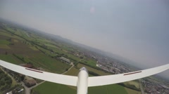 Glider (sailplane) lands in a grass airfield. 4K UltraHD - stock footage
