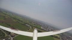 Glider (sailplane) lands in a grass airfield. 4K UltraHD Stock Footage