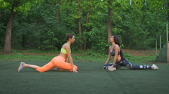 Young sportswoman stretching and preparing to run - stock footage