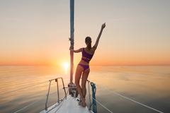 Girl standing on yacht bow. - stock photo