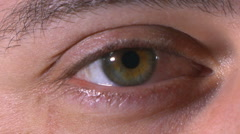 Close-up of male eye opens then blinks Stock Footage