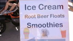 Ice cream truck sign at the Farmers Market in the Summer. Stock Footage