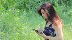 The Girl in the Woods with an iPhone - stock footage