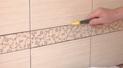 Man cleaning ceramic tiles in the kitchen Stock Footage
