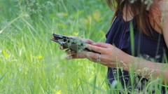 Young Girl Tourist using Map app on Smartphone in the Forest. Stock Footage