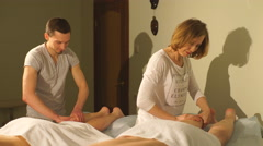 man and woman doing a couples foot massage - stock footage