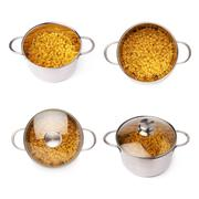 Set of metal pan filled with dry ditalini pasta over isolated white background - stock photo
