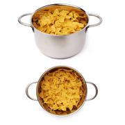 Set of metal pan filled with dry farfalle pasta over isolated white background Stock Photos