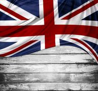 Union Jack flag on wooden boards - stock photo