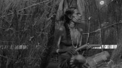 Aboriginal woman play Aboriginal music with Clapstick Stock Footage