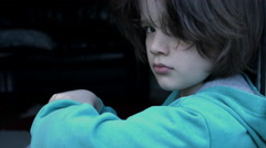 4k shoot of a cute child looking dramatic at the camera. Depressive mood - stock footage