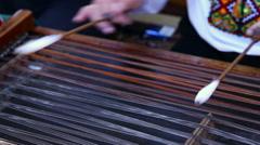 Musician hand play dulcimer, folk Stock Footage