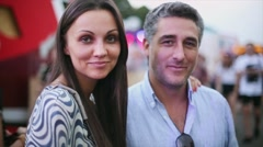 Young attractive woman and aged man smiling in camera. Dating couple. Summer Stock Footage
