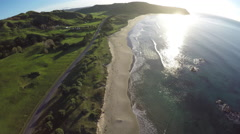 Aerial view of scenic coastal highway and ocean at sunrise Stock Footage