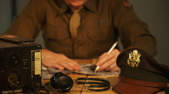 wwii army air corps officer going over aerial photographs - stock footage