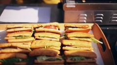 Cook put freshly cooked sandwiches into packet. Fast street food. Summer sunny Stock Footage
