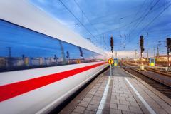 High speed passenger train on tracks in motion - stock photo