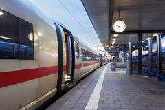 High speed passenger train on railroad platform. Railway station - stock photo