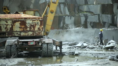 Granite mining in stone quarry Stock Footage