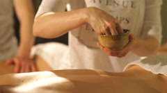 a woman makes a man a back massage - stock footage