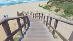 Walk Down via Wooden Stairs with Railing Stock Footage