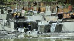 Granite mining in stone quarry Stock Footage