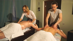 Young couple doing a couples back massage Stock Footage