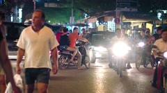 Night movement of pedestrians and vehicles on the streets. Typical chaos. Stock Footage