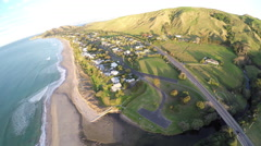 Aerial view of coastal neighborhood and scenic highway in Gisborne, New Zealand Stock Footage
