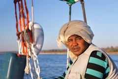 Portrait of Nubian felucca sailing crew man on trip on the Nile. - stock photo