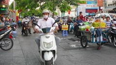 Motorcycles bypassing traffic on the sidewalk in Ho Chi Minh City Stock Footage