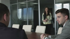 Two businessmen are waiting for a new contract in a meeting hall. Stock Footage