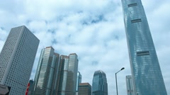 Tall buildings tower over urban highway in Hong Kong, with sound - stock footage