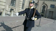 Soldier on Sentry guard duty Royal Palace, Stockholm in Summer sunshine Stock Footage