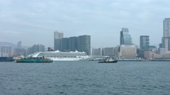 Tugboats towing barges through Victoria Harbor on a cloudy day Stock Footage