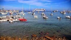 Boats and a ship at Catalina island harbor near Los Angeles, California Stock Footage