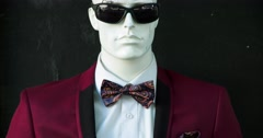 4K, RAW, Fashion mannequin of security agent with glasses and bow tie Stock Footage