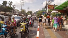 Celebrants dancing and splashing in streets at Songkran Festival. Thailand Stock Footage