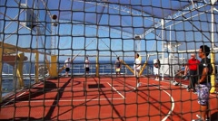Tourists play basketball on the desk of the cruise ship Stock Footage