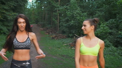 Beautiful young women walking outdoors. They just ran a long distance, they rest Stock Footage