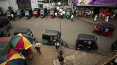 A day in the life of Sri Lanka - tuk tuks waiting for pick up Stock Footage