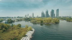Establishing aerial shot of a city as viewed from over a lake. 4K footage. - stock footage