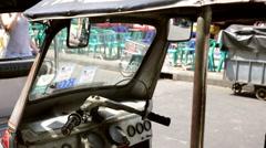 Tuk tuk mirror passing female tourist Stock Footage