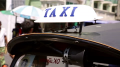 Taxi sign on roof of Tuk Tuk Bangkok Stock Footage