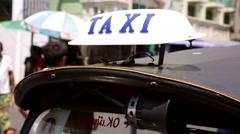 Taxi sign on roof of Tuk Tuk Bangkok - stock footage