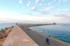 Heraklion. Breakwater in the seaport Stock Photos
