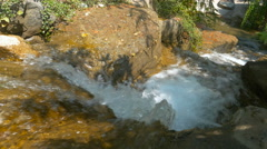 Forest stream falling down throught the stones - stock footage