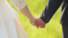 Young married couple holding hands, ceremony wedding day - stock footage
